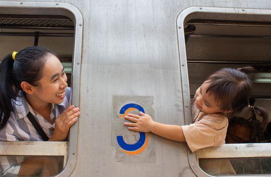 Asian family sitting on Vintage diesel engine train at Khun Tan railway station, Lamphun Thailand.