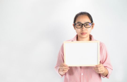 Serious face Asian woman holding blank white board for copy placed isolated on a white background.