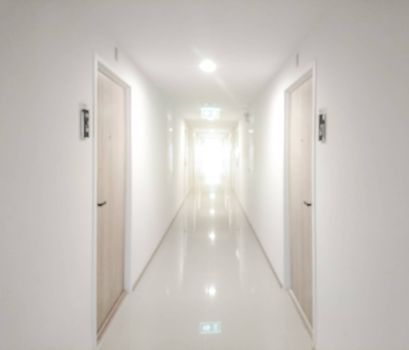 Abstract blurred of walkway with door in apartment