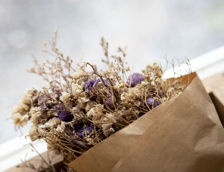 Bouquet of dried flowers in brown paper