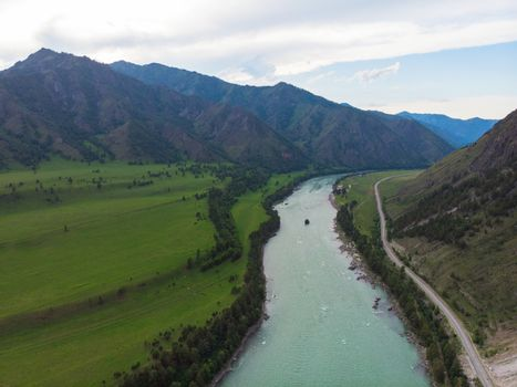 Aerial view of Katun river, in Altai mountains, in beauty summer evening, drone shot