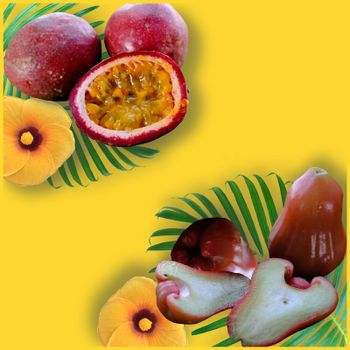 Tropical fruits on the yellow background. Ripe passion fruits (maracuya) and Rose Apple with palm leafs of whole and cut. Top view Exotic fruits