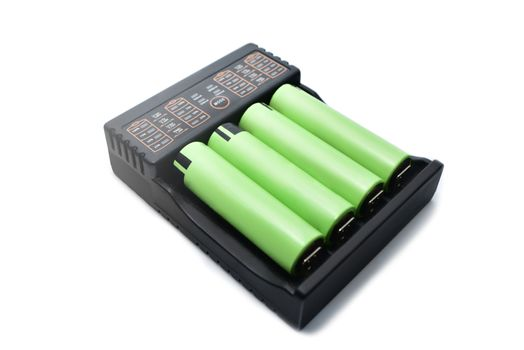 Quick charger and accumulators isolated on white background