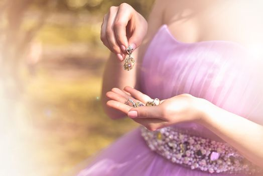 Wedding jewels in female hands close-up. vintage dress. fashion.
