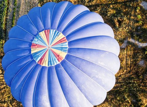 View from above onto a blue balloon shortly before landing in Cappadocia, Anatolia, Turkey, taken from the hot-air balloon