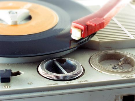 Detail shot of a record player with red head