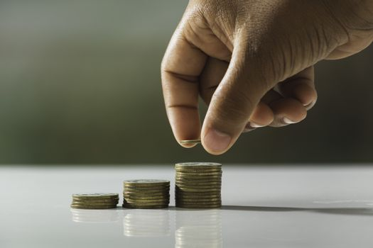Hand drop a coin with money coin stack growing for business. fin