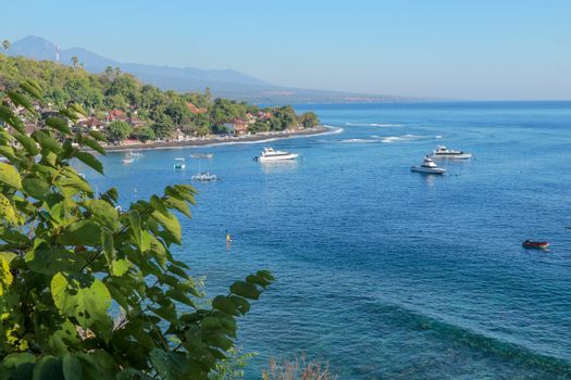 Jemeluk Bay, Amed. Amed is fast becoming a popular tourist destination in Bali, Indonesia. Set in the North-East of Bali, it is a home to excellent snorkeling, scuba diving, freediving and yoga.
