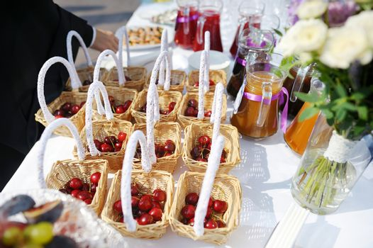 A few cherry baskets on an event party