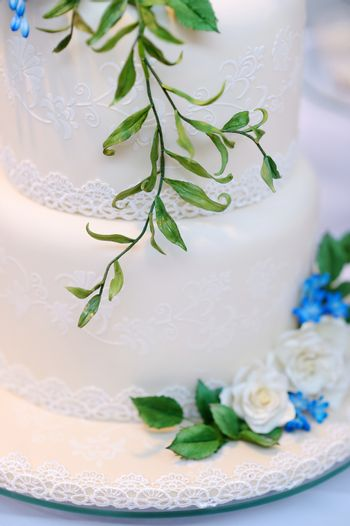White wedding cake decorated with flowers