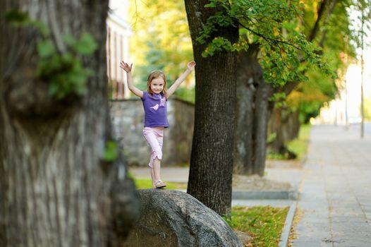 Adorable little girl having a walk