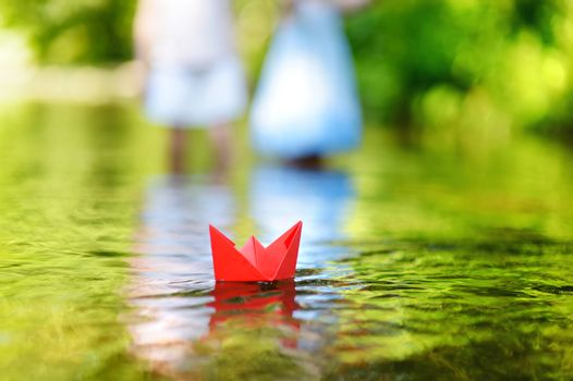 A paper boat floating on a river