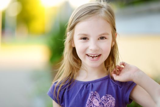 Adorable little girl lost her tooth