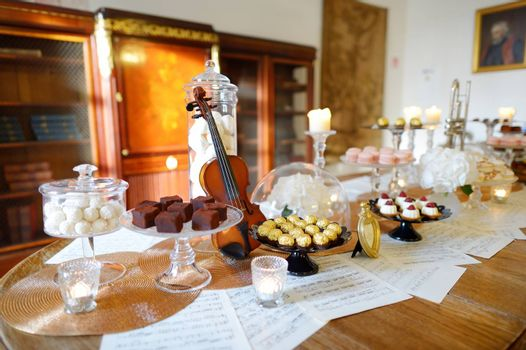 Beautiful desserts, sweets and candy table at wedding reception ot other event