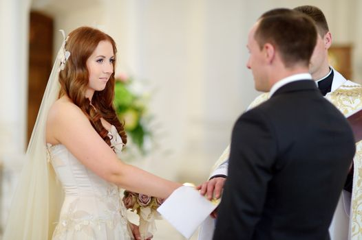 Bride and groom at the church during a wedding ceremony