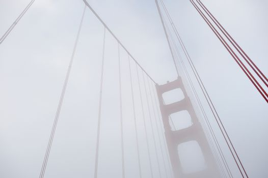 World famous Golden Gate Bridge covered by fog after in San Francisco