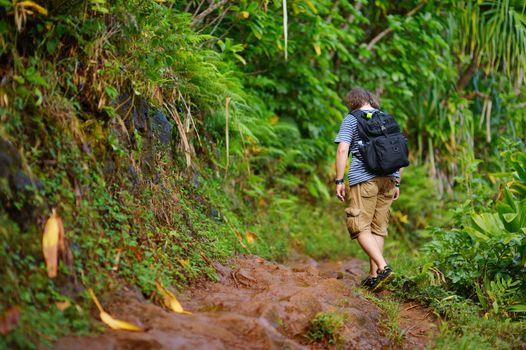 Young hiker on Kalalau trail in Kauai, Hawaii