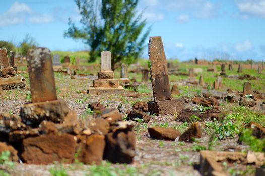 Very old chinese grave headstones abandoned near Glass Beach in Kauai