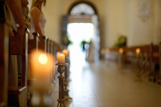 Beautiful candle wedding decoration in a church during wedding ceremony