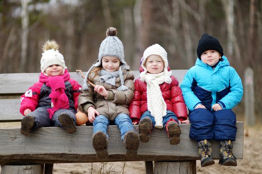 Four kids having fun on early spring or late autumn