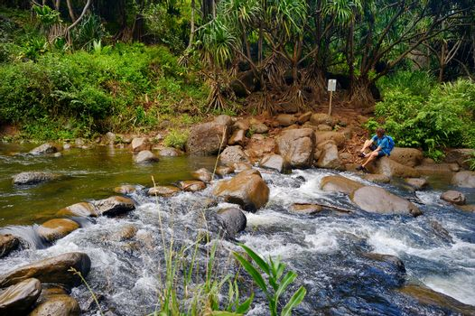 Crossing a small tropical river or stream