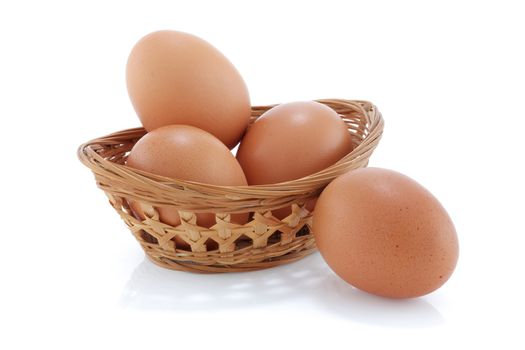 Some Brown chicken eggs in a bamboo basket