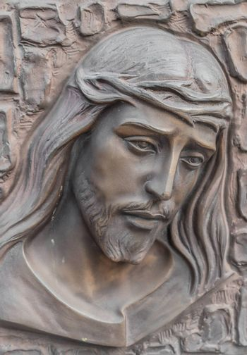 Bronze Bas-relief of Christ with a crown of thorns. Ideal for concepts and backgrounds.