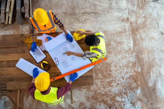 Team engineer and architects are meeting to plan for new project  measuring layout of building blueprints in construction site,working, discussing,planning.