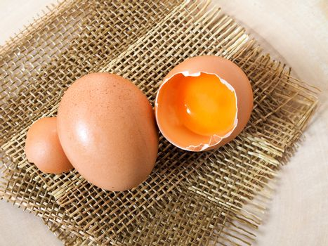 Eggs and cracked eggs with yolk inside Put on sackcloth