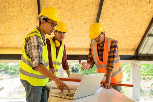 Engineer and architect meeting or discussing work in office or construction site.