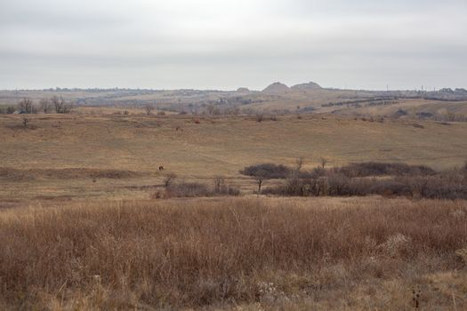 Autumn lanscape in the steppes with slagheap