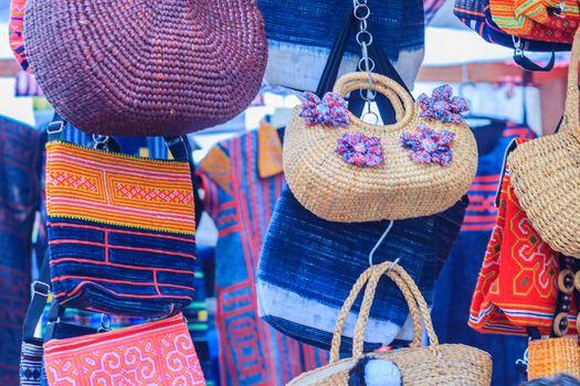 Beautiful weaved dried water hyacinth lady handbag for sale on the walking street market in Bangkok, Thailand.