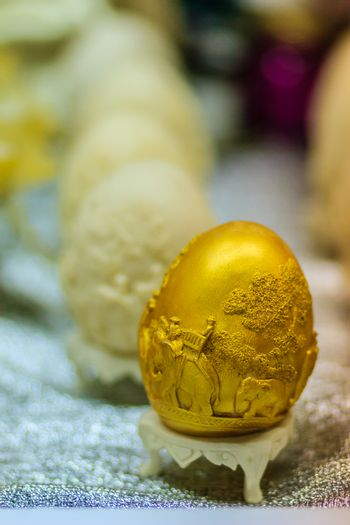 Beautiful Ester egg with Thai pattern. Handwriting inscription Happy Easter in Thai Style patterns.