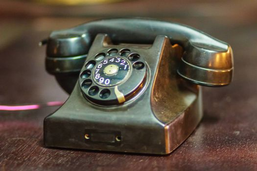 Vintage old rotary telephone. Antique rotary telephone collection.