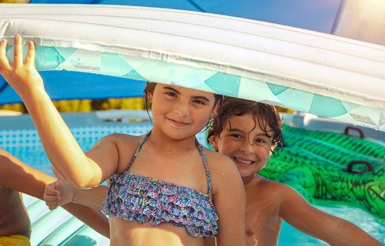 Cheerful Kids in the Pool