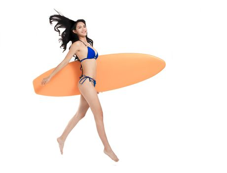 side view Beautiful young woman holding surfboard and running . isolated on white
