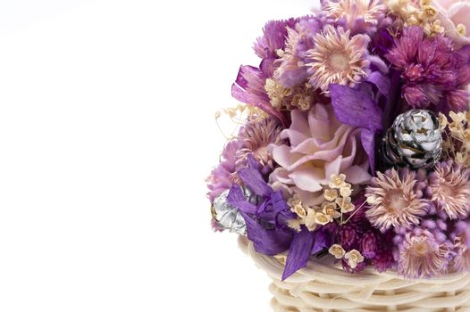 A basket of dried wild flowers on white background. Macro image. Closed up.