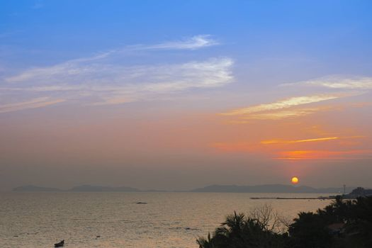 A beautiful display of light in the sky just before sunsetting over Pala beach in Eastern Thailand.