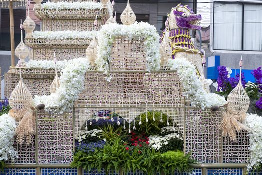 A colorful floral float depicting garden and mythical animals in an annual flower festival parade in Chiang mai, Thailand.