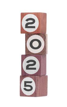 Four isolated hardwood toy blocks, saying 2025