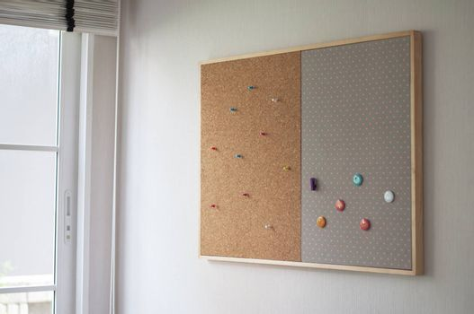 cork board on the wall office for note information and communication. blank cork board with colorful pin on wood frame. empty infomation on cork board.