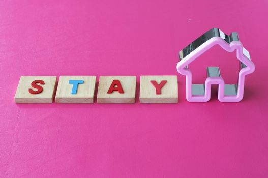 Stay at home for safe. Covid -19 virus. Coronavirus. Stop infection. stay home text on pink background.