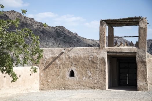 Main entrance of the ancient Fort Al Hayl (Hail) which occupies an important strategic position and a unity point for the road to Fujairah. Built in 1930 (estimation) at west bank of the valley of Al Hayl on a mountain, in the era of Mohammed bin Hamad Al Sharqi