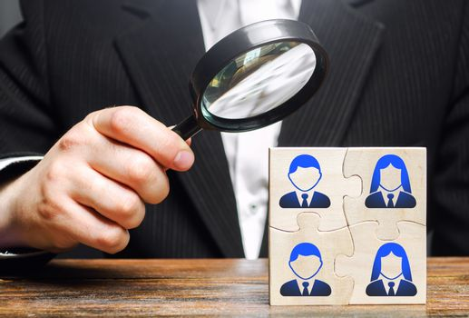 The leader explores the puzzle team of employees. Improving teamwork, efficiency and productivity. Search, hiring and recruitment staff. Leadership and skills. Successful business