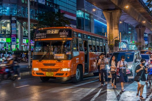 Bangkok, Thailand - February 28, 2017 : Unidentified people travel by bus in Bangkok. Buses are one of the most important public transport system in Bangkok.