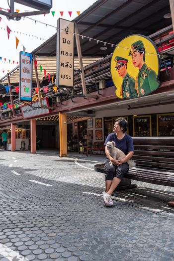 Prachuap Khiri Khan, Thailand - June 18, 2017 : Asian and her dog travel at Mercado de Plearnwan is tourist attraction in Hua Hin recreated retro village plus charming colorful accommodations.