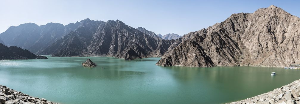 Panoramic view of Hatta Dam  where people can enjoy kayaking and boating on the lake. United Arab Emirates