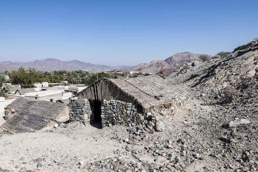Houses in stones at Hatta Heritage Village, preserved, reconstructed and opened in 2001 by the government to showcase rural living dating back centuries. Dubai Emirates, United Arab Emirates