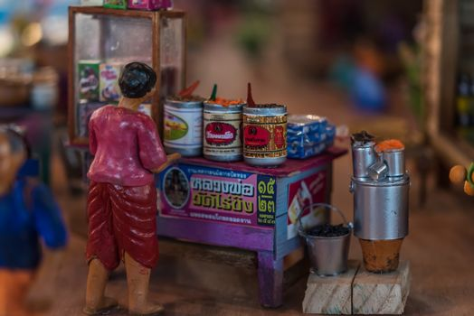 PathumThani, Thailand - August 5, 2017 : Asian clay doll and wooden market store model with ancient lifestyle model at Zeer Rangsit. This a open event no need press credentials required.