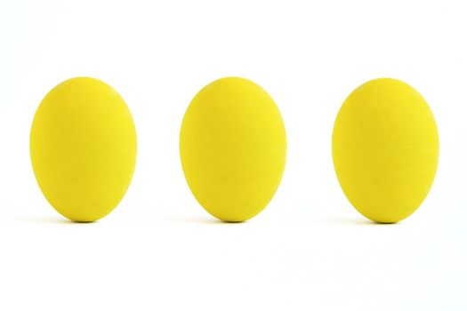 Three yellow paint eggs. isolated on white background